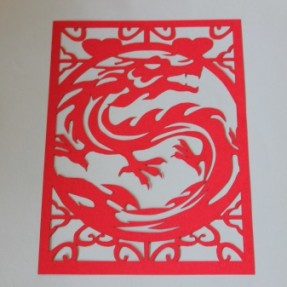 Laser paper cutting – red dragon cutting